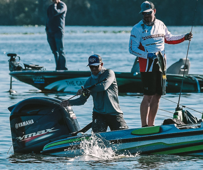 andrew-upshaw-on-his-boat-at-a-fishing-tournament-late-summer-largemouth